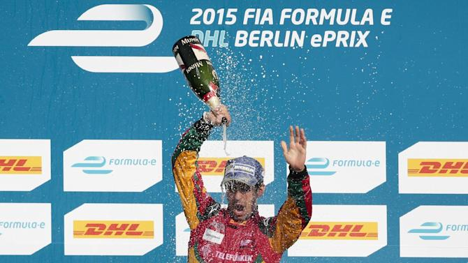 Brazil's Luca di Grassi of the Audi Sport Abt racing team celebrates after winning the Formula E Berlin ePrix auto race at the former airport Tempelhof, in Berlin, Germany, Saturday, May 23, 2015.  (AP Photo/Markus Schreiber)