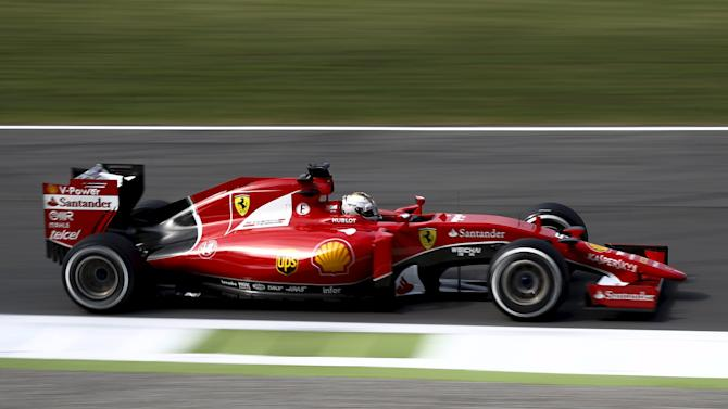 Ferrari Formula One driver Vettel of Germany drives his car during the first free practice session for the Italian F1 Grand Prix in Monza