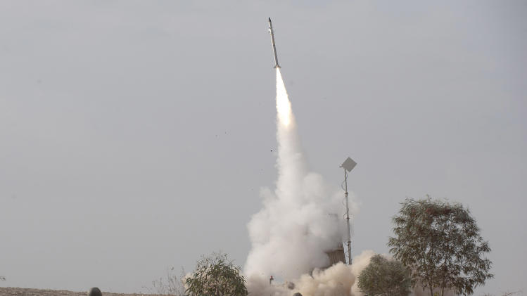 An Israeli Iron Dome missile is launched near the city of Be'er Sheva, southern Israel, to intercept a rocket fired from Gaza Saturday, Nov. 17, 2012. Israel bombarded the Hamas-ruled Gaza Strip with nearly 200 airstrikes early Saturday, the military said, widening a blistering assault on Gaza rocket operations to include the prime minister's headquarters, a police compound and a vast network of smuggling tunnels. (AP Photo/Ahikam Seri)