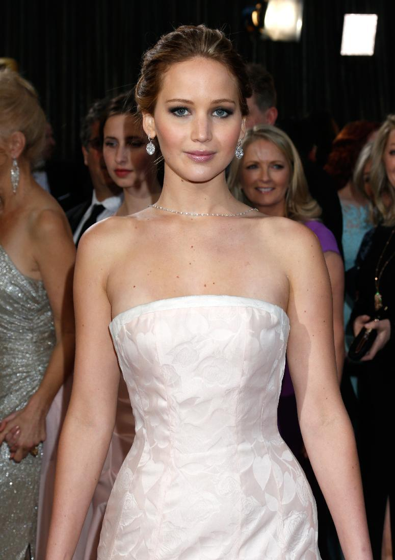 Actress Jennifer Lawrence arrives at the Oscars at the Dolby Theatre on Sunday Feb. 24, 2013, in Los Angeles. (Photo by Todd Williamson/Invision/AP)