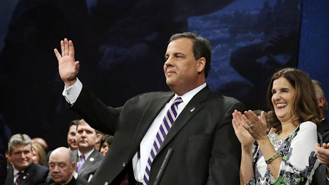 In this Jan. 21, 2014, photo, New Jersey Gov. Chris Christie waves as he stands with his wife Mary Pat Christie during a gathering for his swearing in for his second term in Trenton, N.J. As controversy grows around Christie, he's finding support in the nation's Hispanic community. Some minority leaders usually aligned with Democrats are giving the Republican governor the benefit of the doubt. They're willing to support Christie, in part, because he has aggressively courted Hispanic voters throughout his first term. (AP Photo/Mel Evans)