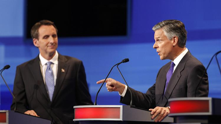 Republican presidential candidates former Utah Gov. Jon Huntsman, left, and former Minnesota Governor Tim Pawlenty are pictured during the Iowa GOP/Fox News Debate at the CY Stephens Auditorium in Ames, Iowa, Thursday, Aug. 11, 2011. (AP Photo/Charlie Neibergall, Pool)