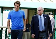 Retired golfer Jack Nicklaus, right, and Roger Federer of Switzerland meet at the All England Lawn Tennis Championships, Wimbledon, England, Saturday, June 30, 2012. (AP Photo/Paul Gilham, Pool)