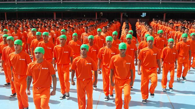 """In this photo taken March, 2010 and released by Portfolio Films Wednesday, April 3, 2013, inmates of Cebu Provincial Detention and Rehabilitation Center perform during the taping of the movie """"Dance of the Steel Bars"""" inside the jail compound in Cebu province, central Philippines. The Filipino inmates whose choreographed """"Thriller"""" dance has attracted 52 million YouTube hits since 2007 are getting their own stories told in a movie. (AP Photo/Portfolio Films) NO SALES"""