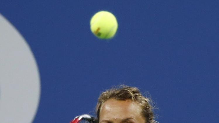 Barbora Zahlavova Strycova of the Czech Republic keeps her eyes on the ball as she returns a shot to Eugenie Bouchard of Canada in their women's singles match at the 2014 U.S. Open tennis tournament in New York