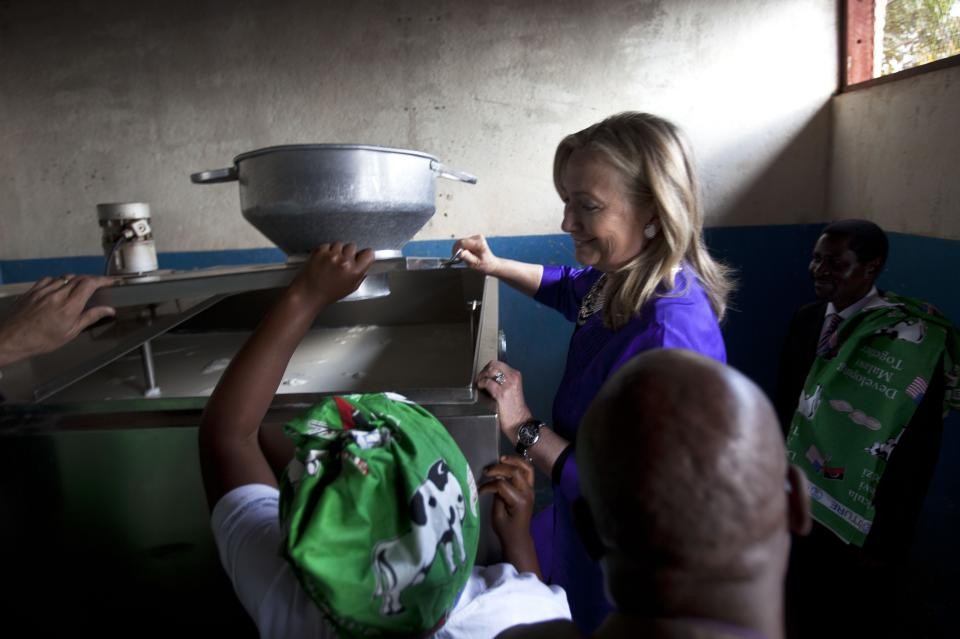 U.S. Secretary of State Hillary Rodham Clinton looks into a container of milk at the Lumbadzi Milk Bulking Group in Lilongwe, Malawi, on Sunday, Aug. 5, 2012, on the first ever visit to Malawi by a U.S. Secretary of State. (AP Photo/Jacquelyn Martin, Pool)