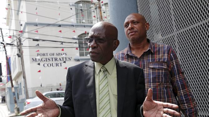 Former FIFA vice-president Jack Warner gestures while talking to reporters after leaving the Magistrates' Court, where he is fighting a request for his extradition to the U.S. on corruption charges, in Port of Spain, Trinidad