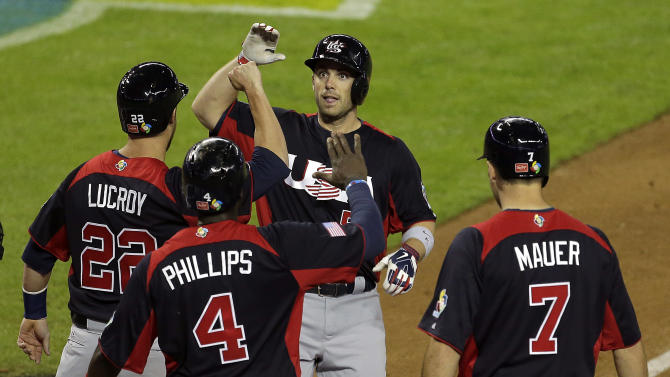 United States's David Wright celebrates as he crosses the plate after hitting a grand slam in the fifth inning of a World Baseball Classic game against Italy Saturday, March 9, 2013, in Phoenix. (AP Photo/Charlie Riedel)