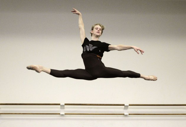 In this Wednesday, Sept. 28, 2011 photo, David Hallberg, 29, regarded as one of the most talented male ballet dancers in the world, poses for a photograph at the American Ballet Theatre studios in New York. In a reversal of tradition, the young American ballet star will be debuting in Moscow this weekend as a premier dancer with the famed Bolshoi Ballet. Hallberg, who will also remain a principal with the New York based American Ballet Theatre, is the first foreign dancer in the Bolshoi's modern history to be given that distinction. (AP Photo/Kathy Willens)