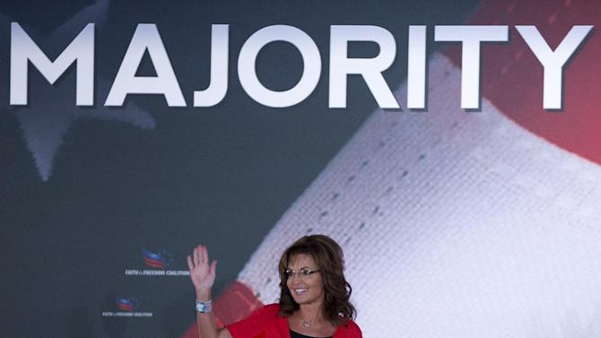 Former Gov. of Alaska Sarah Palin waves to the audience during the Faith and Freedom Coalition Road to Majority 2013 conference, Saturday, June 15, 2013, in Washington. Religious conservatives have been skeptical of the RNC's plan for growth, which calls for more tolerant attitudes on immigration and social issues, such as abortion and gay marriage. Palin, the conference's final speaker, rejected calls for an immigration overhaul that includes a path to citizenship for immigrants in the country illegally. (AP Photo/Carolyn Kaster)(AP Photo/Carolyn Kaster)