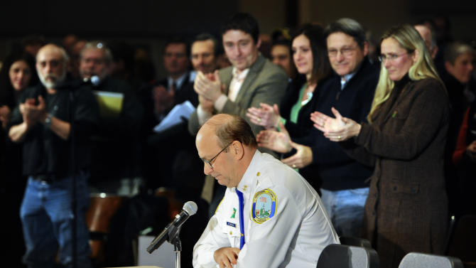 Newtown Chief of Police Michael Kehoe receives a standing ovation from families of the victims of the Sandy Hook Elementary School shooting during a hearing to a legislative task force on gun violence and children's safety at Newtown High School in Newtown, Conn., Wednesday, Jan. 30, 2013. Connecticut lawmakers are in Newtown for the hearing, where those invited to give testimony include first responders and families with children enrolled at Sandy Hook Elementary. (AP Photo/Jessica Hill)
