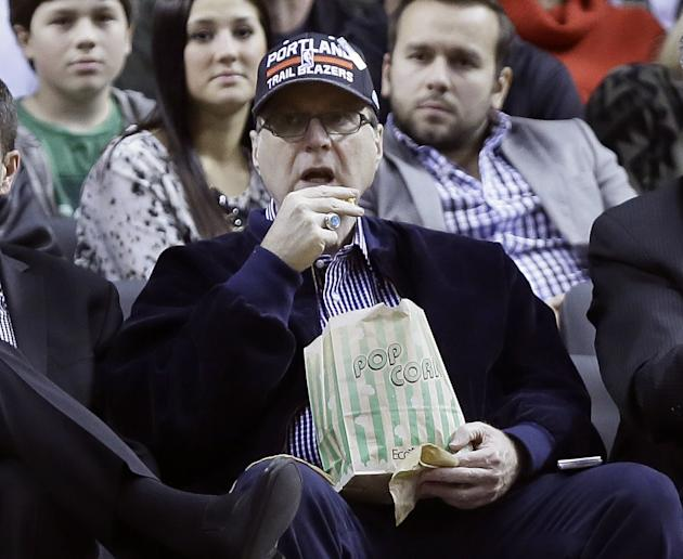 Portland Trail Blazers owner Paul Allen watches from his seat under the basket during the second half of an NBA basketball game against the Denver Nuggets in Portland, Ore., Thursday, Jan. 23, 2014.