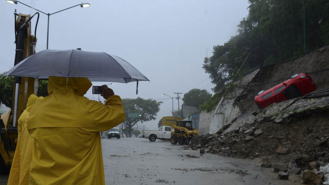 Big storms hit Mexico on opposite coasts; 33 dead