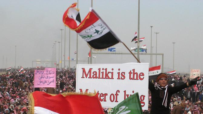 "Protesters chant slogans against Iraq's Shiite-led government as they wave national flags during a demonstration in Fallujah, 40 miles (65 kilometers) west of Baghdad, Iraq, Friday, Jan. 18, 2013. Thousands of Sunnis are rallying in western and central Iraq against the Shiite-led government's policies they see as sidelining their minority group. Friday's protests come amid rising tensions among Iraq's ethnic and sectarian groups that are threatening to plunge the country into more instability. Partially obscured sign reads, ""Maliki is the master of lying."" (AP Photo)"