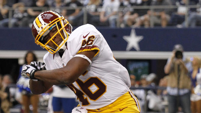 Washington Redskins' Alfred Morris (46) celebrates his touchdown run against the Dallas Cowboys in the first half of an NFL football game, Thursday, Nov. 22, 2012, in Arlington, Texas. (AP Photo/Tim Sharp)