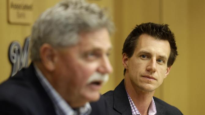 Milwaukee Brewers new manager Craig Counsell listens to general manager Doug Melvin speak at a baseball news conference Monday, May 4, 2015, in Milwaukee. Counsell replaces manager Ron Roenicke who was fired on Sunday. (AP Photo/Morry Gash)
