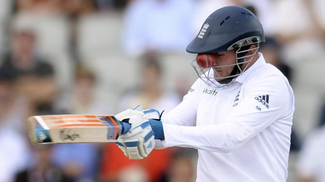 File photo of England's Broad edging the ball that gets stuck in the grill of his helmet from a delivery from India's Aaron during the fourth cricket test match in Manchester