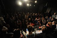 "People watch a documentary play about the Pussy Riot trial in a theatre in Moscow, late on August 27. Audience members packed the black-painted Teatr.doc cellar theatre for the free show named after the trial venue, ""Khamovnichesky Court. The Sequel."""