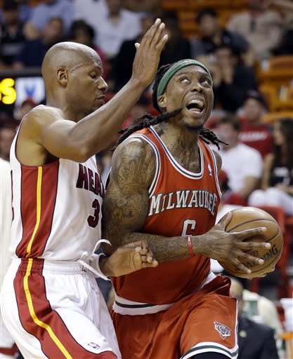 Milwaukee Bucks forward Marquis Daniels, right, drives for the basket past Miami Heat guard Ray Allen during the second half of an NBA basketball game, Tuesday, April 9, 2013 in Miami. The Heat defeated the Bucks 94-83