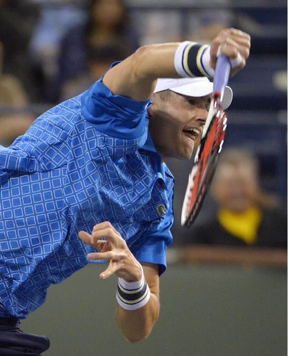 John Isner, of the United States, serves to Lu Yen-Hsun, of Taiwan, at the BNP Paribas Open tennis tournament, Tuesday, March 11, 2014, in Indian Wells, Calif