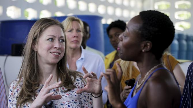 Clinton Foundation Vice Chair Chelsea Clinton talks to Yve-Car Momperousse, founder of Kreyol Essence, during a visit to the production facilities of the CETPA in Mirebalais