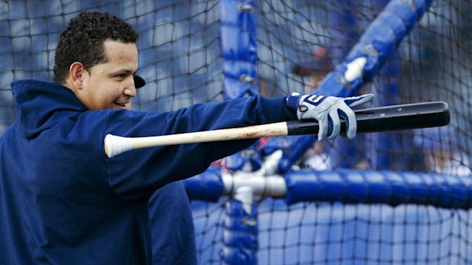 Detroit Tigers' Miguel Cabrera points to fans during batting practice before a baseball game with the Kansas City Royals at Kauffman Stadium in Kansas City, Mo., Wednesday, Oct. 3, 2012. (AP Photo/Orlin Wagner)