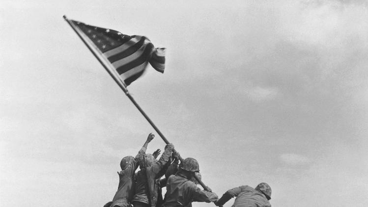 FILE - U.S. Marines of the 28th Regiment, 5th Division, raise the American flag atop Mt. Suribachi, Iwo Jima, on Feb. 23, 1945 during World War II. (AP Photo/Joe Rosenthal, File)