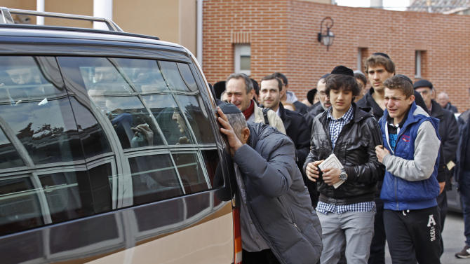 Mourners follow the hearse carrying the coffins of the victims following a ceremony at the Ozar Hatorah Jewish school where a gunman opened fire killing four people in Toulouse, southwestern France, Tuesday, March 20, 2012.  A father and his two sons were among four people who died Monday when a gunman opened fire in front of a Jewish school in a city in southwest France, the Toulouse prosecutor said Monday.(AP Photo/Remy de la Mauviniere)