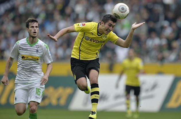 Dortmund's Nuri Sahin of Turkey, right, heads the ball in front of Moenchengladbach's Havard Nordtveit of Norway during the German first division Bundesliga soccer match between Borussia Moenchengladb