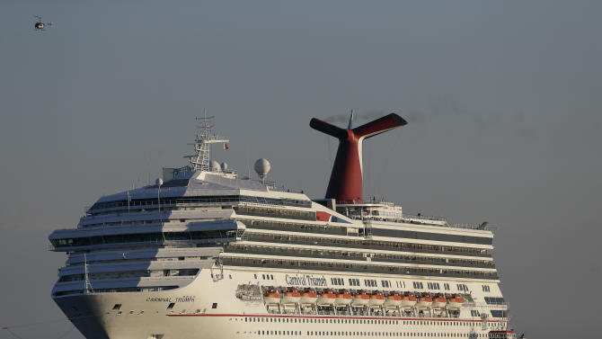Crews try to corral cruise ship that tore loose