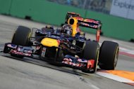 Red Bull-Renault driver Sebastian Vettel of Germany negotiates a turn during the third practice session at Formula One's Singapore Grand Prix. Vettel, despite leading all three practice sessions before Sunday's steamy Asian night race, will be on the second row of the grid