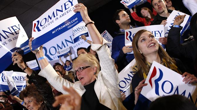 Supporters cheer as election results come in at the Super Tuesday primary watch party for Republican presidential candidate, former Massachusetts Gov. Mitt Romney in Boston, Tuesday, March 6, 2012. (AP Photo/Gerald Herbert)