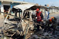 A destroyed vehicle at the site of a suicide bomb attack in Darra Adam Khel. The blast happened near to a local anti-insurgent peace committee office, which officials said was the target of the attack