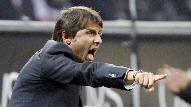FILE --  In this Oct. 29, 2011 file photo Juventus coach Antonio Conte gestures during the Serie A soccer match between Inter Milan and Juventus at the San Siro stadium in Milan, Italy. Soccer is falling under a cloud of suspicion as never before, sullied by a multibillion-dollar web of match-fixing that is staining increasingly larger parts of the world's most popular sport. FIFA bans include some elite figures in the sport. Antonio Conte, coach of the Italian club Juventus _ a team whose winning tradition rivals that of baseball's New York Yankees _ returned in December after a fourth-month ban for failing to report match-fixing. (AP Photo/Antonio Calanni, File)