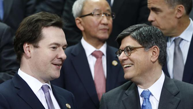 Britain Chancellor of the Exchequer George Osborne, left, talks with U.S. Treasury Secretary Jack Lew during a group photo of the G20 finance ministers and central bank governors on the sidelines of their meeting at World Bank Group International Monetary Fund Spring Meetings in Washington, Friday, April 19, 2013. (AP Photo/Charles Dharapak)
