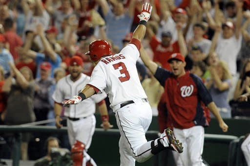 Nationals come back to beat Phillies 4-3 in 11