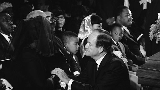 FILE - Vice President Hubert Humphrey speaks to Mrs.Coretta  King Jr, before funeral services for Dr. Martin Luther King Jr in Atlanta on April 9, 1968. At left is Dr. King's brother, the Rev. A. D. King, at center is Mrs. King's younger daughter, Bernice, 5.  The civil rights leader was standing on the balcony of the Lorraine Motel when he was killed by a rifle bullet on April 4, 1968. James Earl Ray pleaded guilty to the killing and was sentenced to 99 years in prison. He died in prison in 1998. (AP Photo)