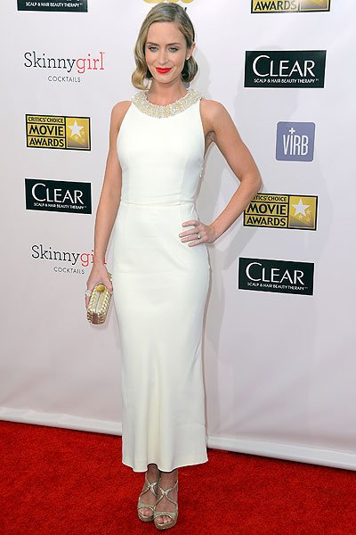 Emily Blunt:  We can always count on Emily to look gorgeous and she doesn't disappoint in this cream Miu Miu ensemble. The dress could have looked drab were it not for the crystal-studded neckline whi