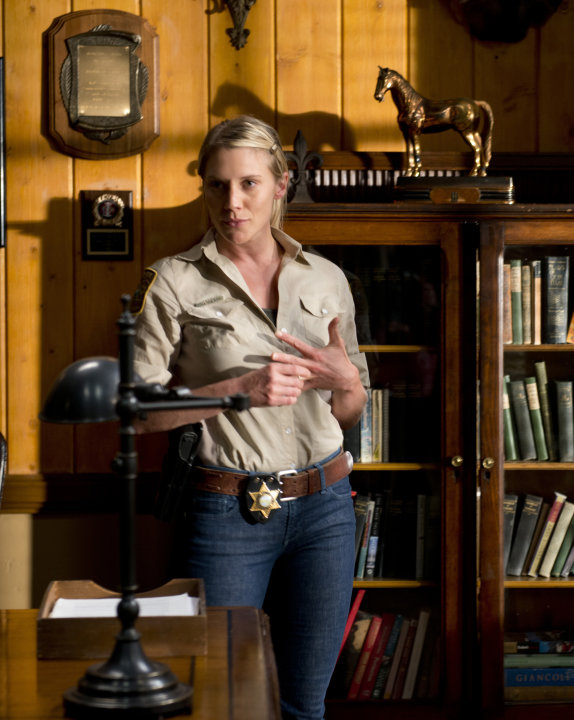 "This undated image released by A&E shows actress Katee Sackhoff portraying Victoria ""Vic"" Moretti in a scene from A&E's new original drama series, ""Longmire.""  Sackhoff, 32, has had success playing wo"