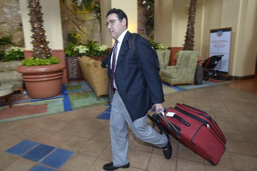 Philadelphia Phillies general manager Ruben Amaro Jr. leaves after the conclusion of baseball's winter meetings in Lake Buena Vista, Fla., Thursday, Dec. 12, 2013
