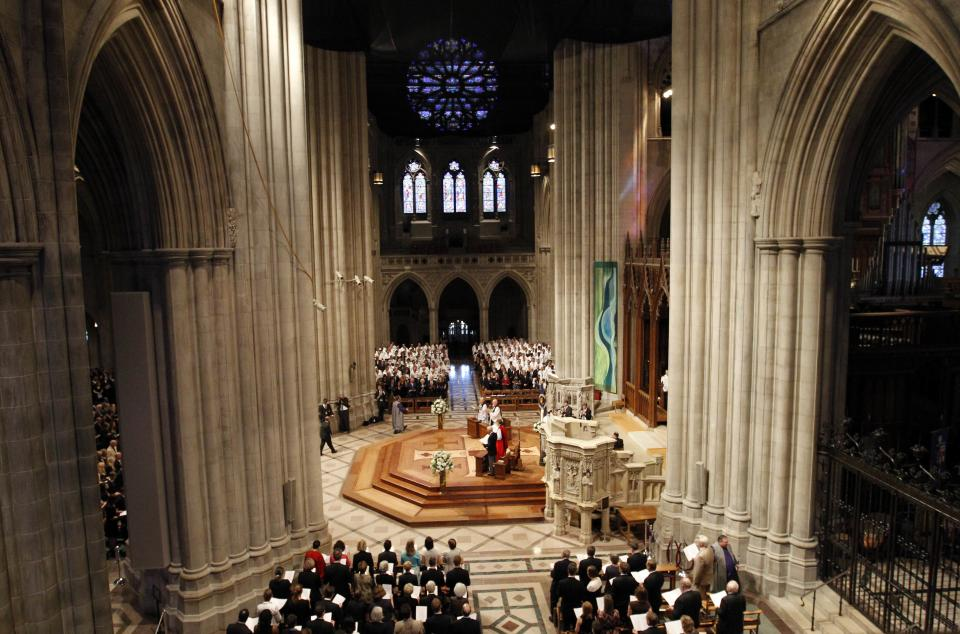 Members of the congregation stand at the Washington National Cathedral in Washington, Thursday, Sept. 13, 2012, during the national memorial service for the first man to walk on the moon, Neil Armstrong. (AP Photo/Ann Heisenfelt)