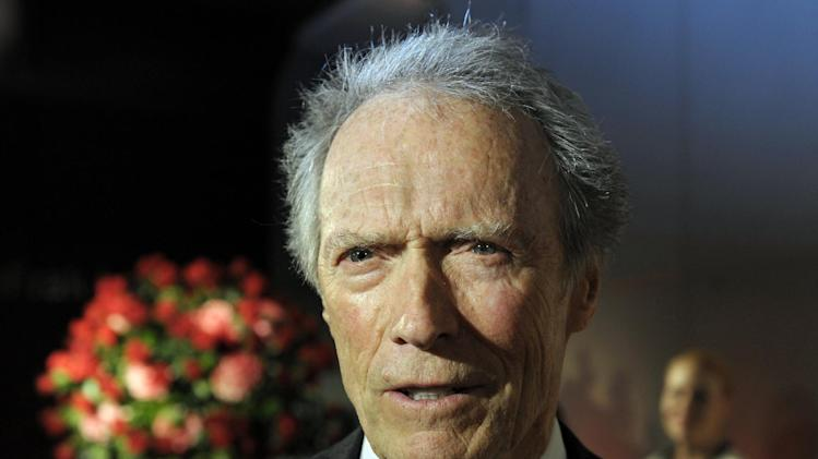 "FILE - In this Feb. 1, 2012 file photo, actor and director Clint Eastwood speaks with reporters during the opening of the Warner Bros. Theater at the Smithsonian National Museum of American History in Washington. Eastwood, the ""Dirty Harry"" star and Oscar-winning director of ""Unforgiven"" and ""Million Dollar Baby"", endorsed the Republican presidential candidate Friday night, Aug. 3, 2012 during a Sun Valley fundraiser.  (AP Photo/Cliff Owen, File)"