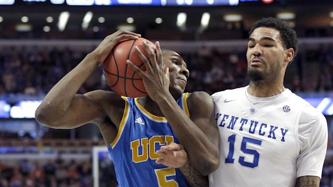 UCLA forward Kevon Looney (5) is pressured by Kentucky forward Willie Cauley-Stein (15) during the first half of an NCAA college basketball game Saturday, Dec. 20, 2014, in Chicago. (AP Photo/Nam Y. Huh)