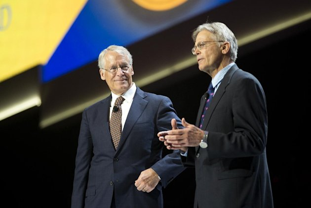 Rob Walton (L) looks at his brother Jim Walton (R) (AP Photo/Sarah Bentham)