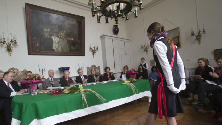 "In this photo taken Friday, March 22, 2013, jury member Michael Edwards, third from left, listens to a contestant during the 21st annual poetry recitation competition at the Maison d'Education de la Legion d'Honneur in Saint Denis, north of Paris. The man who will soon become the newest official guardian of the French language has spoken: English, he says, is jumping the barricades and threatening the language of Moliere. Edwards should know. He's British - the first to become one of the 40 esteemed ""immortals"" of the Academie Francaise, the institution that has watched over the French language since 1635. (AP Photo/Michel Euler)"