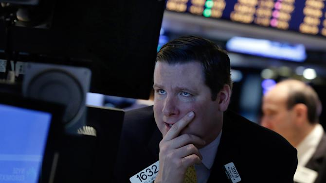 FILE - In this Monday, March 3, 2014, file photo, specialist Gregg Maloney works on the floor of the New York Stock Exchange. Global shares were mixed with European shares getting an early boost Thursday, April 24, 2014 but stocks in Tokyo slipped after talks between Japan's prime minister and visiting President Barack Obama failed to finalize a trade agreement. (AP Photo/Richard Drew, File)