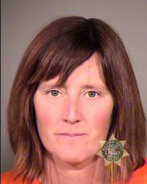This undated photo provided by the Multnomah County Sheriff's Office in Portland, Ore., shows Rebecca Rubin, 39, of Canada, who turned herself in to face federal charges alleging she was part of a radical environmental group based in Eugene, Ore., known as The Family. Federal authorities blame the group for 20 fires across the West between 1996 and 2001 that did $40 million in damage. Rubin was to be arraigned Friday, Sept. 11, 2013 in U.S. District Court in Eugene, Ore., on conspiracy and arson indictments. (AP Photo/Multnomah County Sheriff's Office)