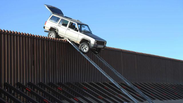 Drug Smugglers' SUV Stuck Atop Border Fence