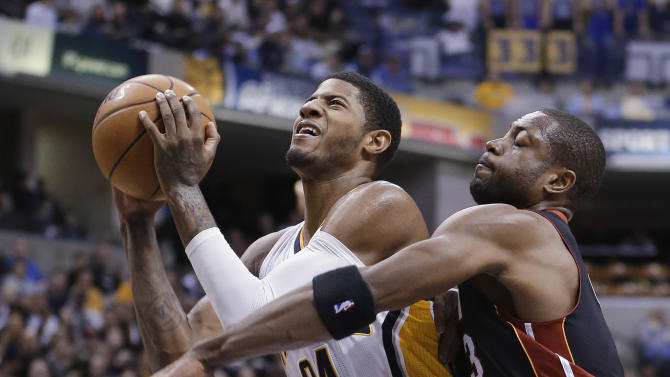 Indiana Pacers' Paul George (24) is fouled by Miami Heat's Dwyane Wade (3) as he goes for up for a shot during the second half of an NBA basketball game Tuesday, Jan. 8, 2013, in Indianapolis. The Pacers defeated the Heat 87-77. (AP Photo/Darron Cummings)