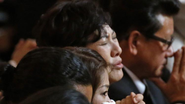 Family prays during a memorial service for LAPD officer Nicholas Lee in Los Angeles